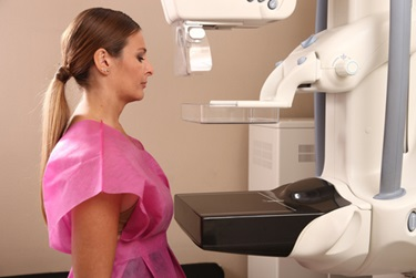 A woman is preparing for her mammogram.