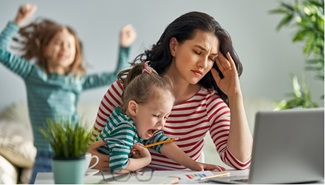 woman with children working at home stressed