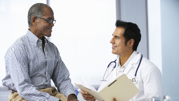A senior male speaking with a health care provider
