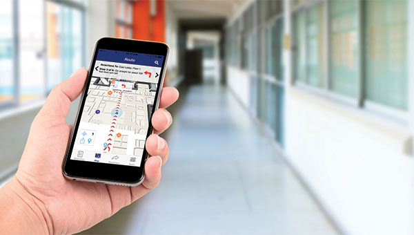 Person using mobile device to navigate the hospital.