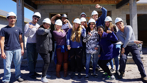 Residents volunteering with Habitat for Humanity