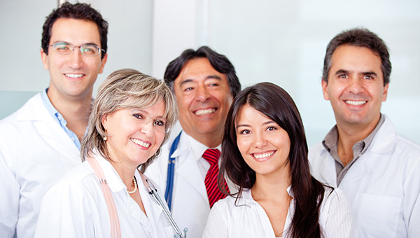 A smiling group of male and female doctors