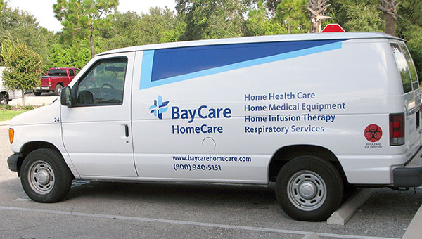 A BayCare HomeCare van parked in a parking lot