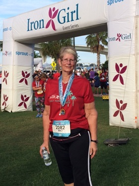Nancy O. at a 5K road race after her bariatric surgery